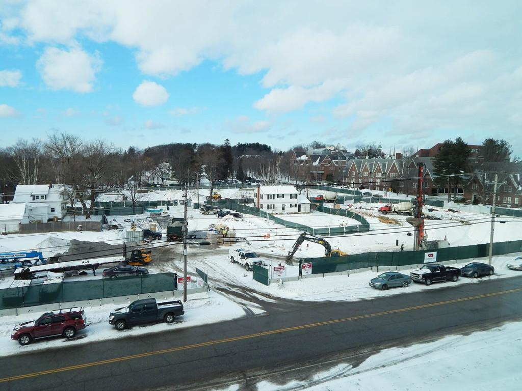 A view of the 65 Campus Ave. construction site from an upper story of Lewiston Middle School on Jan. 9, 2015. At right, the orange boom and the two concrete trucks roughly indicate the placement of the student residence. (Doug Hubley/Courtesy Photo of Bates College Office of Communications)