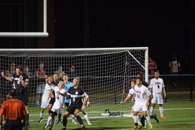 The Bates defense fights for position on a corner kick.   JOHN NEUFELD/BATES STUDENT