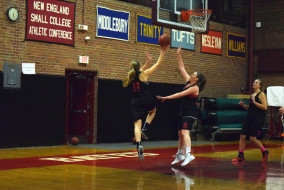 First-year Erika Lamere rises for a layup as the Bobcats practice in Alumni Gym.   John Neufeld/The Bates Student