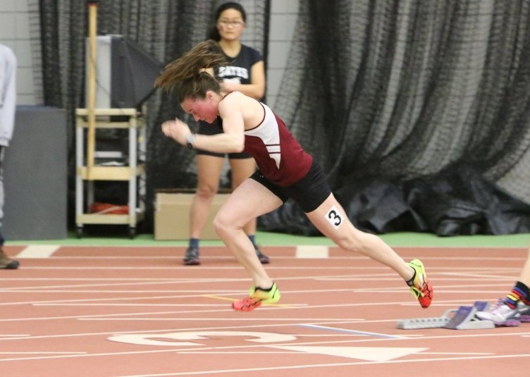 Claire Markonic '17 sprints out of the blocks.   Tom Leonard '78/Courtesy Photo