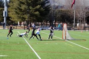 Senior Emma Brinkman beats the Wesleyan goaltender. (Alison Mackay/The Bates Student)