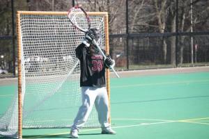 Hannah Jeffrey '16 patrols the net. (Joanie Oates/Courtesy Photo)