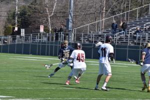 Senior Jack Allard fires one of his 22 goals on the season. (John Neufeld/The Bates Student)