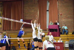Hannah Tardie '17 right, and Claire Naughton '19 go up for a block, while Maggie Paulich '17 looks on. JOHN NEUFELD/THE BATES STUDENT