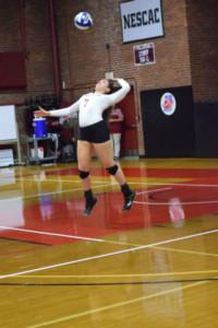Jordan Camarillo '20 leans into a serve. JOHN NEUFELD/THE BATES STUDENT