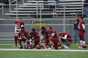 From left to right, Bates football players Walter Washington '19, Marquise Scott '20, Mickoy Nichol '18 and Andrew Segal '17 kneel during the national anthem in their game against Colby last week.JOHN NEUFELD/THE BATES STUDENT