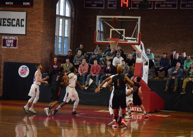 The Bobcats battle for a rebound Saturday against Wesleyan. JOHN NEUFELD/THE BATES STUDENT