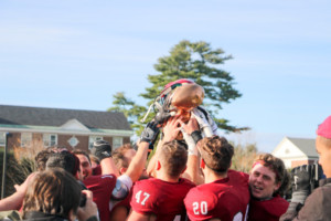 The football team celebrates after their big win against Bowdoin, clinching the CBB title. .  SARAH dU PONT/THE BATES STUDENT.