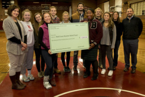 Vantiel Elizabeth Duncan '10 of American Red Cross accepts $1,311.14 check from SAAC on November 10, 2017. PHYLLIS GRABER JENSEN/BATES COLLEGE